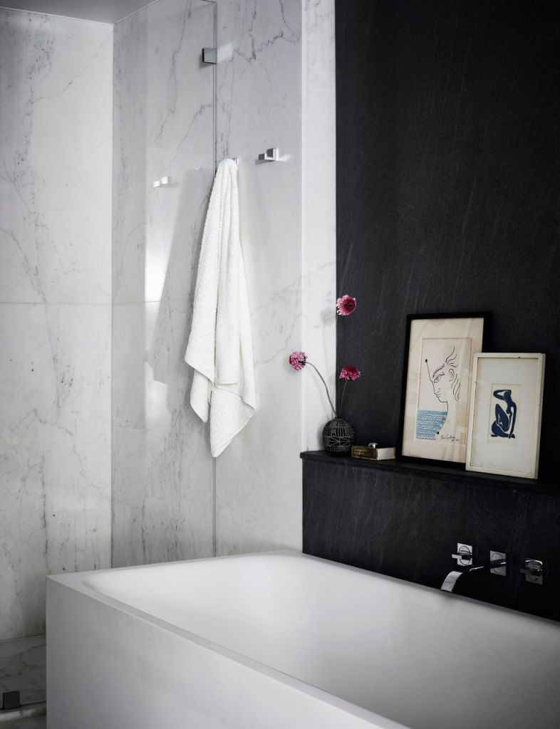 black-and-white master bath with a soft vibe