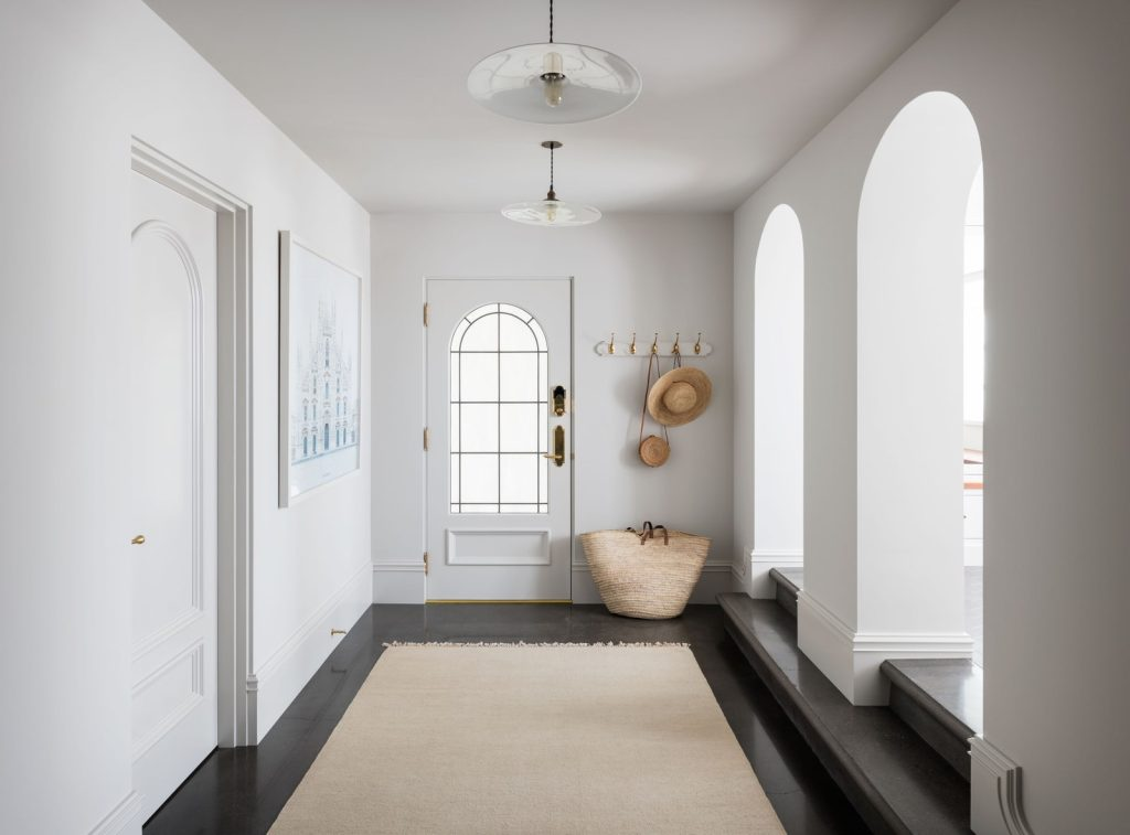 A Calming Hallway With A Muted White Paint
