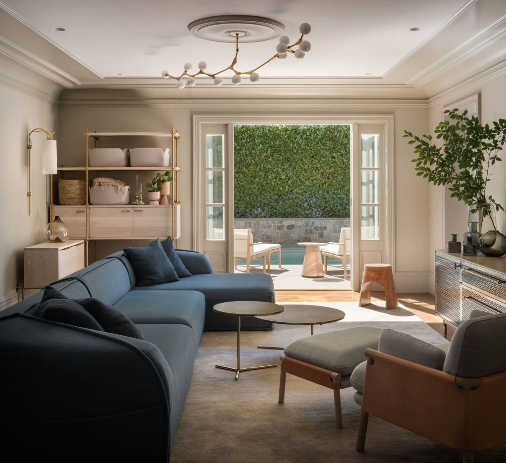 A Dark Blue Sectional Set A Relaxing Tone For This Family Room