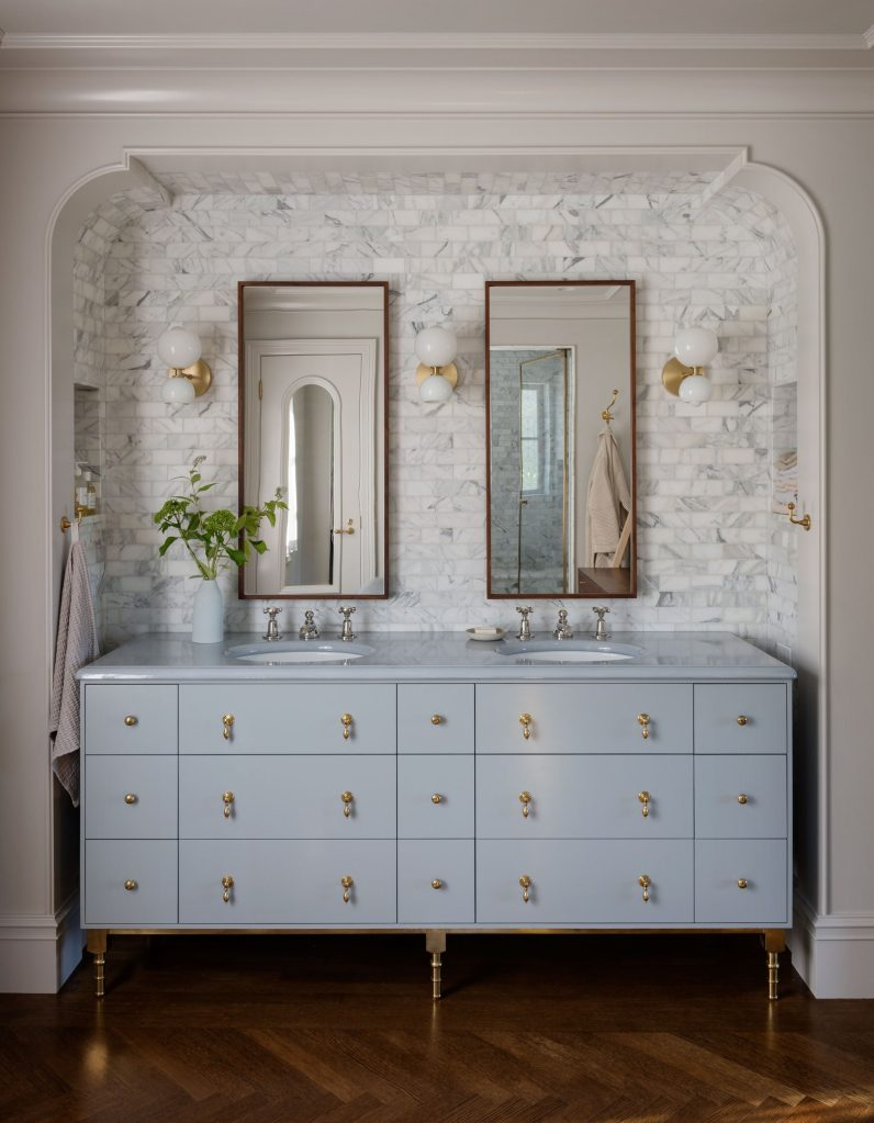 Light Blue Vanity With Brass Details