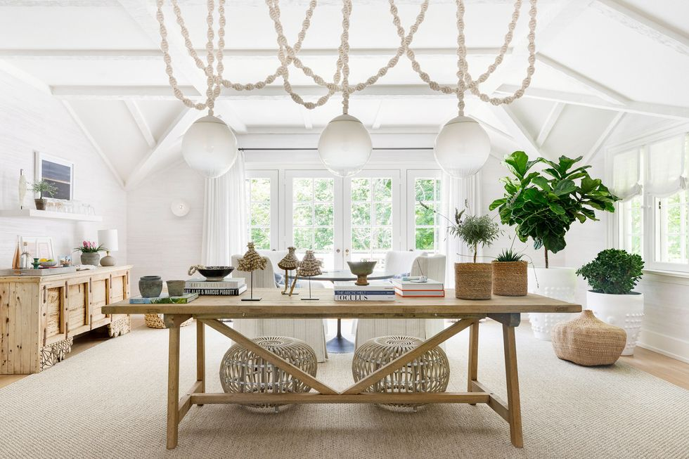 An oversized chanderlier is a focal point in this airy and organic living room.