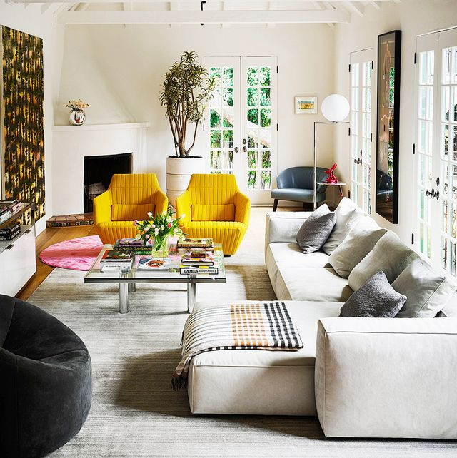 A pair of modern channeled chairs add warmth and happiness to this well-designed cozy living room
