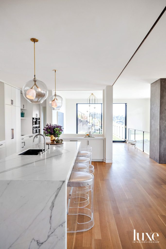 marble kitchen island with lucite bar stools