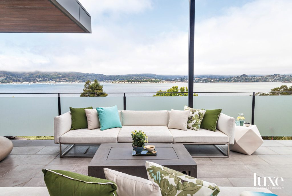 chic outdoor living spaces featuring with floral outdoor pillows