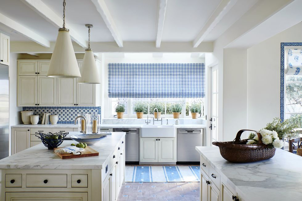 classical blue backsplash with checkered blue curtain in the white kitchen