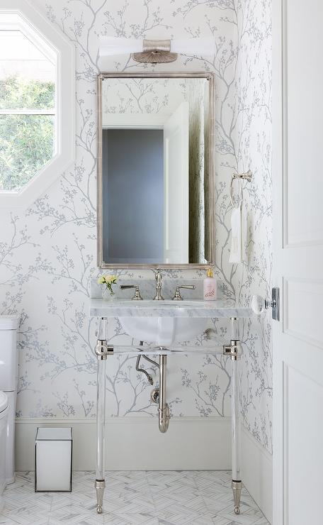 Silver- wallpaper-wrapped powder room