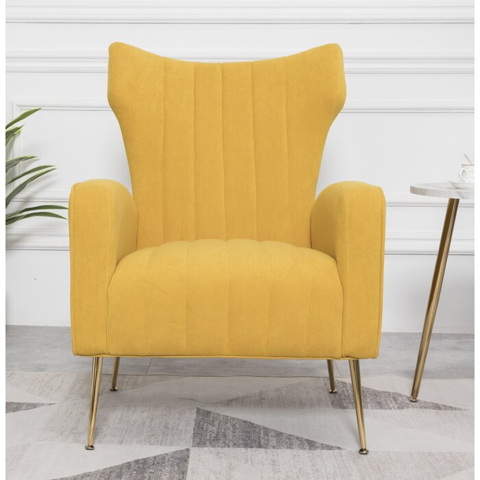 modern yellow lounge chair with brass legs