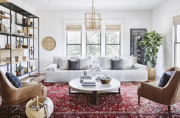 vintage area rug adds a sense of history to this all0white room