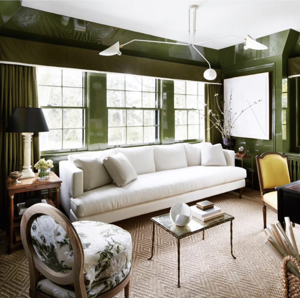 An understated elegant living room featuring with lacquering green walls