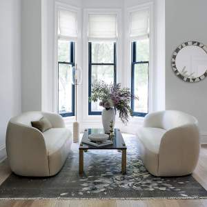 """Ivory leather gives our best-selling silhouette from the goop collection an update reminiscent of '70s mod. Luxe, hand-treated cowhide with a vintage-inspired frame and a totally high-end, of-the-now feel. CB2 exclusive.  Gwyneth Ivory Leather Loveseat. 68""""Wx36""""Dx29""""H Designed by goop 100% semi-aniline cowhide leather Pine and plywood frame Blot spills immediately Made in Vietnam"""