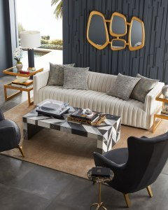 """Handcrafted sofa features dramatic channeling, for trend-forward texture and sumptuous sit. Hardwood frame. Body: viscose/polyester/linen. Outer: 97""""W x 35""""D x 26.5""""T. Inner: 85""""W x 24""""D x 35""""D. Arm height, 26"""". Seat width, 85"""". Seat depth, 24"""". Seat height, 16.5"""". Professional cleaner is recommended. Imported. Boxed weight, approximately 139 lbs."""