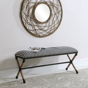 Rustic iron frame with a nautical touch, wrapped in natural fiber rope accents. Cushioned top is a sturdy, cotton in a neutral oatmeal.