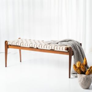 Accent your entryway with the carefully crafted Dilan bench. The mahogany wood frame features tapered legs and a raised seat, covered with woven leather. Choose from white or brown leather to match your boho decor.   Features: Mahogany wood frame Woven top-grade leather seat Boho, contemporary style Light brown finish White or brown leather Tapered legs Raised seat Rectangular shape Assembled Measures 18.1 inches high x 50.8 inches wide x 16.5 inches deep