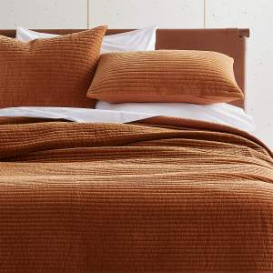 Pure cotton velvet quilt is dip-dyed by hand to achieve a gorgeous copper ombre effect in a light-to-dark gradient. Feels slightly distressed for an edgy-glamorous look. Pair with matching shams for the full effect.